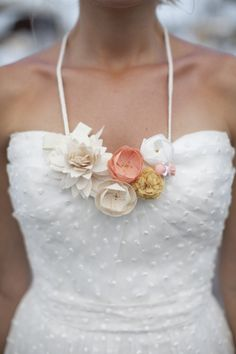 paper flowers. such a cute addition to a plain white dress