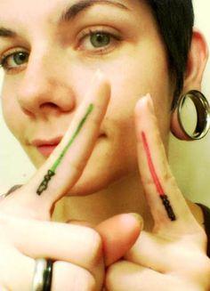1-2-3-4 let's have a thumb war...  star-wars-lightsaber-finger-tattoos