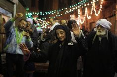 """An Egyptian elderly woman dances in a trance-like state at an moulid, has won first place in the UNESCO's """"Unite For Heritage"""" worldwide competition. (Mohamed AbdelGawad / Mada Masr)"""