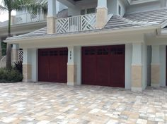 Wow!  This garage door really makes the whole house.  It looks so good.  I love the red and how it stands out.