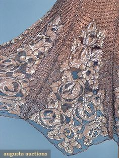 BEADED & SEQUINNED DECO DRESS, MID 1920s Pink net covered in silver bugle beads, the skirt having floral panels worked in pink iridescent sequinned Deco roses, original slip. Detail