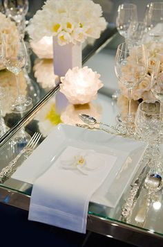 A single bloom, such as an orchid, adds an element of sweetness to this luxurious seasonal table setting.