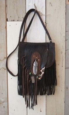 Feather on leather might make a nice pendent Srta-Pepis
