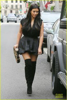 Kim Kardashian carrying a Dolce & Gabbana clutch.