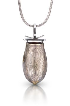 """Vessel pendant entitled """"Shibuya"""" by Cyd Rowley. Sterling silver and bronze, hand made 2"""" high."""