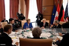 German Chancellor Angela Merkel, US President Donald Trump, Italian Prime Minister Paolo Gentiloni, Japanese Prime Minister Shinzo Abe, Britain's Prime Minister Theresa May, the President of the European Council Donald Tusk, the President of the European Commission Jean-Claude Juncker and Canadian Prime Minister Justin Trudeau attend a working lunch during the Summit of the Heads of State and of Government of the G7, the group of most industrialized economies, plus the European Union, on May…