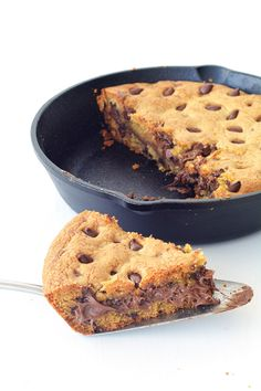 Nutella Stuffed Skillet Cookie made from scratch! A BIG buttery deep dish chocolate chip cookie made in a skillet with a secret layer of gooey Nutella hidden inside! Hi guys, it's Jess from Sweetest Menu. I'm an Aussie girl who loves to create America-inspired recipes. And today I have quite the treat for you. This …