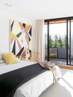 Love the large graphic art and color pops against white and grey