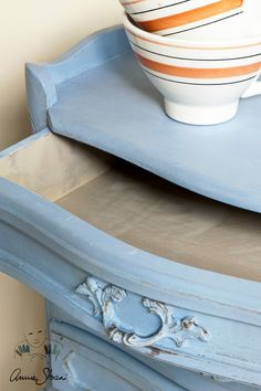 French Elegance style side table painted with Chalk Paint® by Annie Sloan in Louis Blue, and French Linen on the inside drawers.