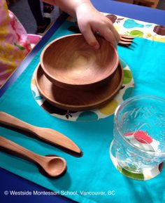 """May I set the table?"" Children love to contribute. Table setting is a practical life skill that gives them extra confidence and independence and is a valued contribution at school and at home. We suggest placing dishes and silverware at a height in your cupboards where they can easily access them."