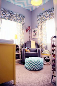Love the chevron ceiling & suzani print curtains!   Possible additions to update nursery to big girl's room