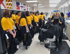 New female recruits receive their first haircuts at the Navy Exchange barber shop inside the Golden 13 Recruit In-processing Center at Recruit Training Command (RTC), Great Lakes, IL. USN photo.