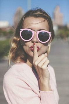 Pastel pink sunglasses.