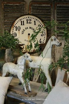 folk horses with clock face....