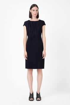 Dress with pleated drapes