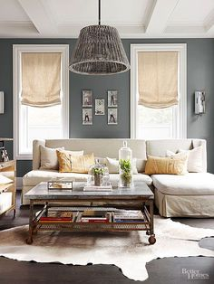 Charcoal + White + Cream With its bright white ceiling and trim set against charcoal gray walls and floors, this room takes on the feel of a vintage black-and-white photo. To soften the room's contrasts, the design introduces cream in the linen sofa, Roman shades, and hide rug.