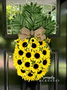 This large pineapple shaped sunflower wreath is perfect to brighten up your front door or as an accent in your home. It measures 31 inches tall, 13 inches wide, and 6.5 inches deep. It has a black chevron burlap bow.