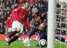 Ryan Giggs of Manchester United (R) scores the second goal during the Barclays Premiership match between Manchester United and Birmingham
