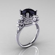 Modern Vintage 14K White Gold 2.5 Carat Black Onyx Ring. I'd prefer a darker metal but damn the metal work on this is awesome.