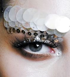 Dior Haute Couture took a note from Chanel and created embellished eyebrows.