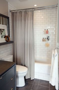 Lovely small bathroom - Dark tile floor, subway tile shower..