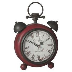 """Vintage-inspired metal desk clock with a weathered finish.    Product: ClockConstruction Material: MetalColor: Distressed redAccommodates: Batteries - not includedDimensions: 9.875"""" H x 6.75"""" W x 3"""" D"""