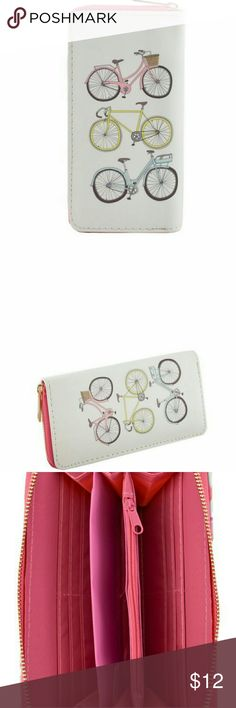 BICYCLE SINGLE ZIP AROUND WALLET Single zip around closure Textured faux leather Inside lining with open/zipper pockets Credit card & Bill holders 7.5 (W) x 1 (D) x 4 (H) inches Lipps Bags Wallets