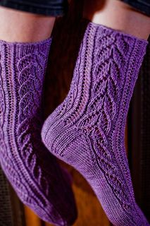 Hunter Hammersen's Crocus Vernus socks. Too gorgeous. Started them over a year ago and frogged twice so gave up and left them hibernating for ages. Frogged one leg completely and lo and behold, I am 90% done and loving them. Ready for winter.