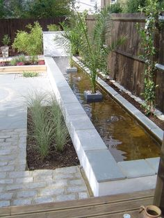 Long-water pond on completion #gardens #gardendesign #landscaping #waterfeature #paving #patio
