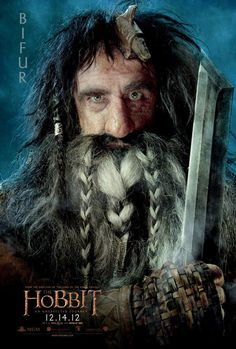BIFUR – Born in the West, Bifur has the rusting remains of an Orc axe embedded in his forehead, which has rendered him inarticulate and occasionally feisty! He communicates only with grunts and hand gestures. Unlike most of the others in The Company of Dwarves, Bifur is not related to Thorin, nor is he of noble lineage, but rather is descended from miners and smithies – simple folk with simple tastes.