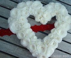 Rolled Paper Flower...plus lots of good tips for making coffee filter wreaths in general.