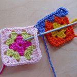 Joining granny squares with crochet.