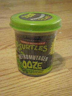 Party favors- Green play-doh with printed labels that say Turtle Ooze on them!