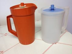 Vintage Tupperware pitchers your choice vivid orange or clear with blue top by EvelynsCornerCabinet, $11.00