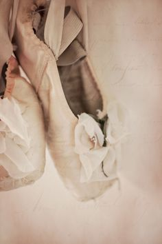 This is magic for any mother whose daughter had a life-long dream of dancing enpointe.  And then brilliantly performed repeated fouettes.  When she removed her shoes, her feet were soaked in blood but she was smiling.  ~ photograph of Pale Pink Ballet Shoes with french text by Kat Warren ~ <3