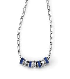 """ROUND ABOUT -- (16-19"""") Rings of cut crystals and cobalt blue opaque enamel twirl endlessly on a fine polished silver chain. -- Spring/Summer 2013"""