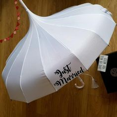 Just Married Pagoda Umbrella - Perfect for wedding photographs! https://www.loveumbrellas.co.uk/collections/wedding-umbrellas/products/wedding-umbrella