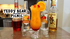 TEDDY BEAR PICNIC 1 oz. (30ml) Spiced Rum 1/2 oz. (15ml) Peach Schnapps 1/2 oz. (15ml) Triple Sec 1/2 oz. (15ml) Strawberry Liqueur 3 oz. (90ml) Orange Juice Garnish: Orange Wheel, Teddy Bears PREPARATION 1. In a shaker with ice, combine strawberry liqueur, peach schnapps, triple sec, spiced rum, and orange juice. Shake well. 2. Pour some grenadine in the base of your serving glass and add ice. 3. Strain the mix over and garnish with an orange slice and a gummy bear skew...