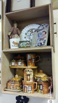 Little thatch house tea set nestled in repurposed drawers.