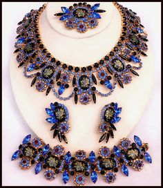 Midnight Rose 2008 DiMartino Originals is the signature of a Tennessee artist who has been making jewelry for more than 20 years. She taught herself the almost-lost art of costume jewelry making; combining it with her copious artistic talent, she has created some of the most beautiful rhinestone jewelry. She uses primarily Swarovski Austrian crystal rhinestones, vintage and hand-painted cabochons, many of which are no longer being made.