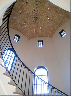 love the little windows at the top, the ceiling, railing and shape of the walls.