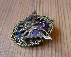 Adorable Steampunk Brooch featuring a polymer clay cabochon decorated with a butterfly.  The cabochon is a unique handmade piece.    The brooch measur