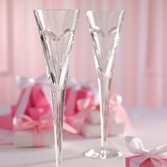 $139.00 per pair - Made in Ireland by Waterford, these clear crystal champagne flutes say quality and romance. From Exclusively Weddings.