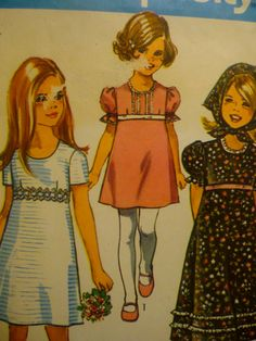 Vintage 1970's Girls Dress I think I had one like the white one. It was red checked on the bottom with a white bodice.
