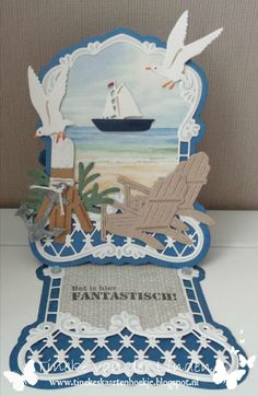 Handmade easel card by DT member Tineke with Collectables Anja's Label (LR0425), Dolphins (LR0332 - for the seaweed), Bear Chair (LR0424), Craftables Tiny's Folding Dies - Nautic (CR1275) and Tiny's Ocean Set (CR1279) from Marianne Design