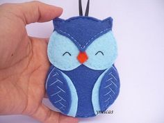 Blue and light blue owl felt Christmas ornament - Felt owl ornament - Owl ornament - Felt Ornament  Decorations for your Christmas tree, hanging from the rearview mirror of your car, or to add a touch of whimsy to any corner of your home.  *** You can have the year or name added for a small fee, great if you treat someone to a new decoration each year. ****  • felt in blue and light blue and orange • 4 x 3 (10.2 x 7.6 cm) (not including the ribbon loop) • stuffed with polyester fiberfill •…