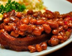 "Recipe | World's Best BBQ Baked Beans ~ With Brown Sugar :: After our daughter got married, we held a big backyard barbeque for all her friends who couldn't make it to her ""destination wedding"" in Hawaii. One of our foodie relatives arrived with a pot of baked beans to share, and they were the yummiest ever. #favorite #side dish"