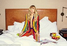 Stunner: Hailey Baldwin went shirtless in a bright striped suit as she posed for Vogue Brazil's April issue