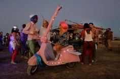 Pretty Pink scooters and ruffled shirts - Karoo, South Africa. AfrikaBurn courtesy of EPA Photos/Kim Ludbrooke