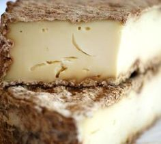 Tommes de Savoie has a beautiful gray-brown rind. The pate is firm with flavor of nuts and sometimes grass. Pairs well with sausages, fruits, or bread.